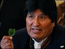Bolivian President Evo Morales holds up a coca leaf at his news conference on 9 March
