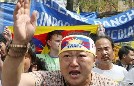 A Tibetan woman shouts slogans during a protest march in Delhi