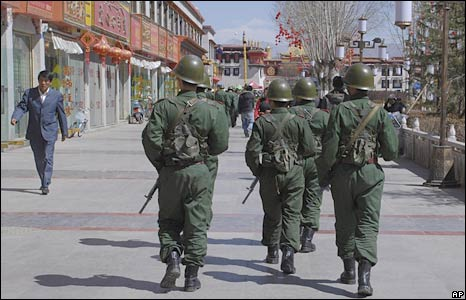 Chinese paramilitary police patrol a street in Tibet's capital, Lhasa, on 9 March 2009