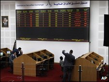 Traders work on the floor of Damascus Stock Exchange