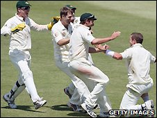 Australia celebrate the wicket of Paul Harris