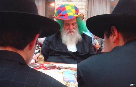 Ultra Orthodox Jews from the Beth Habad group read the esther scrolls at a synagogue in the Israeli coastal town of Netanya during the Jewish holiday of Purim