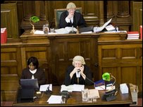 Judge Lord Neil Denison , and Court Clarks Nike Adebajo and Yvonne Powell