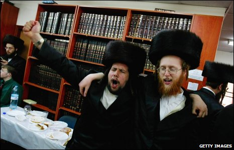 After several glasses of wine, ultra-Orthodox Jews dance during Purim festivities at their synagogue in Bnei Brak