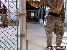 Soldier and detainee at Guantanamo Bay prison - 21/12009