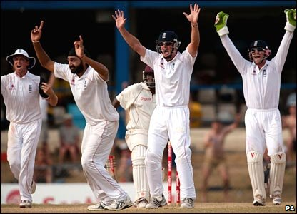 England celebrate Panesar's success