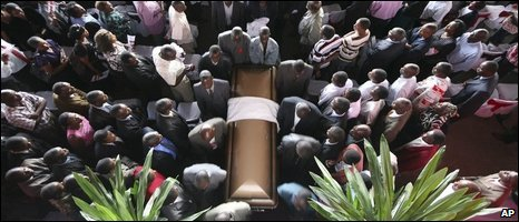 Mourners gather around the coffin of Susan Tsvangirai