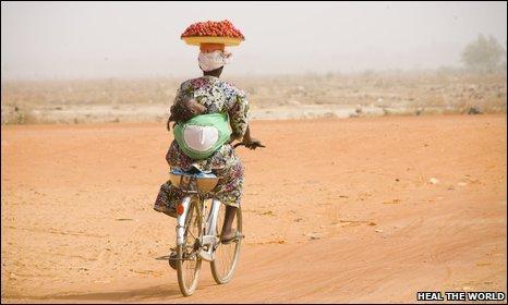 Market seller with strawberries, Ouagadougou, Burkina Faso