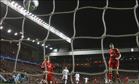 Fernando Torres (right) puts Liverpool on the way to victory over Real Madrid