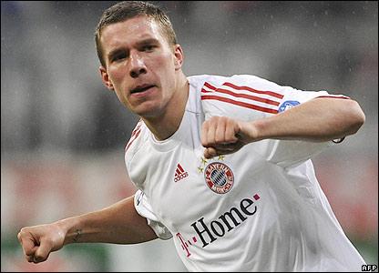 Podolski celebrates the opening goal