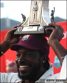 Chris Gayle holds aloft the Wisden Trophy