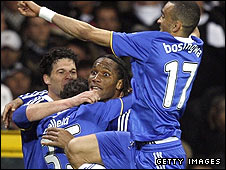 Chelsea's players celebrate Didier Drogba's decisive late goal