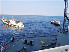 Two Chinese trawlers stop directly in front of the USNS Impeccable on 8 March 2009 (image: US Navy)