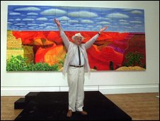 David Hockney in front of his Grand Canyon painting