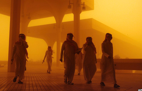 Men walk through the sandstorm