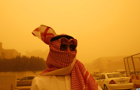 Man with headscarf covering his face
