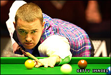 Stephen Hendry plays a shot at this year's Masters