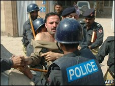 Pakistani policemen arrest a supporter of former premier Nawaz Sharif, during a protest in Multan on March 11, 2009