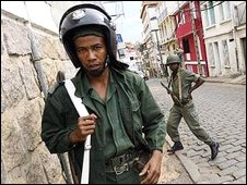 A Malagasy policeman stands guard in Antananarivo, Madagascar, 10 March 2009