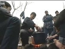 Afghan men in woods outside Calais