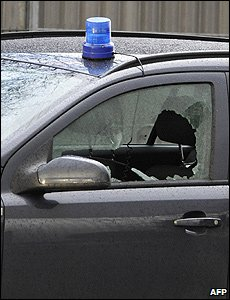 The broken window of a police car in Wendlingen, Germany