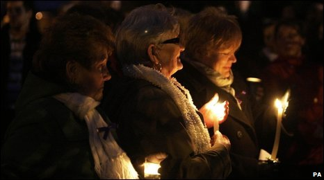 Women holding candles