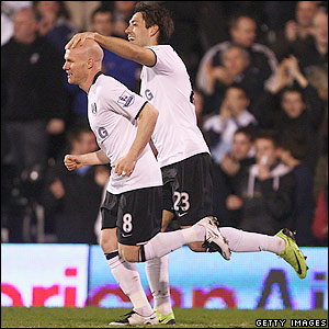 Dempsey celebrates with Andy Johnson