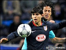 Sergio Aguero tussles with Porto's Bruno Alves