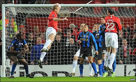Man Utd centre-back Nemanja Vidic scores against Inter Milan  at Old Trafford