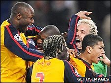 Arsenal players celebrate after winning the penalty shoot-out
