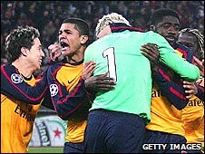 Arsenal players celebrate after beating Roma in a penalty shoot-out