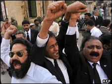 Pakistani lawyers shout slogans during a protest before the start of a long march in Karachi on March 12, 2009