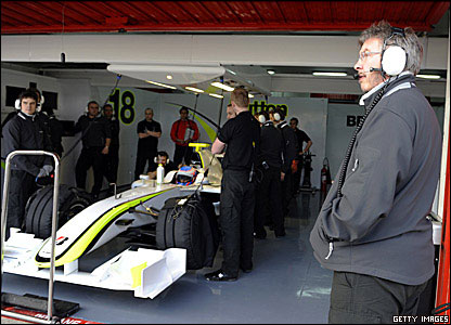 Ross Brawn watches as Jenson Button prepares to take the new Brawn out on to the track in Barcelona testing