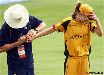 Australia's teenage seam bowler Elysse Perry cannot bear to lookas the team physio restores a dislocated finger to its normal position