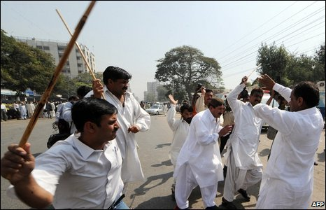 Pakistani plain clothes policemen beat political party activists during a protest in Karachi on March 12, 2009