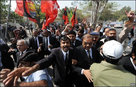 Pakistani lawyers and political activists during a protest in Karachi on March 12, 2009