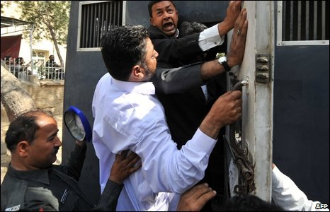 Pakistani policemen arrest lawyers during a protest rally in Karachi on March 12, 2009