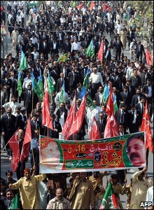 Pakistani lawyers and political party activists march during a protest rally in Lahore on March 12, 2009