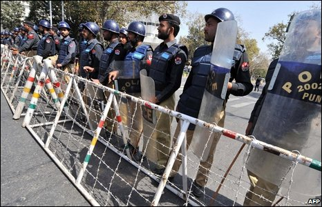 Pakistani riot police block a street during a protest in Lahore on March 12, 2009