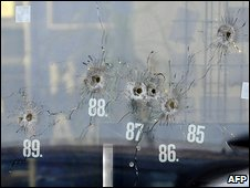 Bulletholes in car showroom