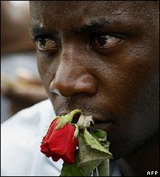 Mourner holding a rose