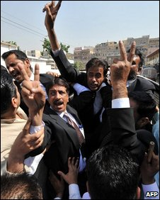 Pakistani lawyers make victory signs after their arrest during a protest rally in Karachi on March 12, 2009.