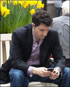 Man using mobile and iPod, BBC