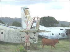 Two rusting aeroplanes on a disused airport on Grenada