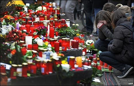 Students lay tributes outside Albertville school in Winnenden, Germany