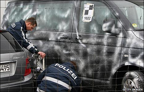 Police investigate a car at a showroom in Wendlingen, Germany