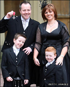 John Higgins with his wife Denise and children Pierce and Oliver,