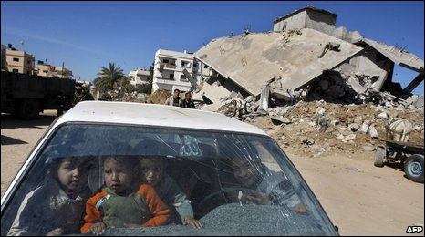 Palestinians drive through Jabalia, in northern Gaza on 4 February