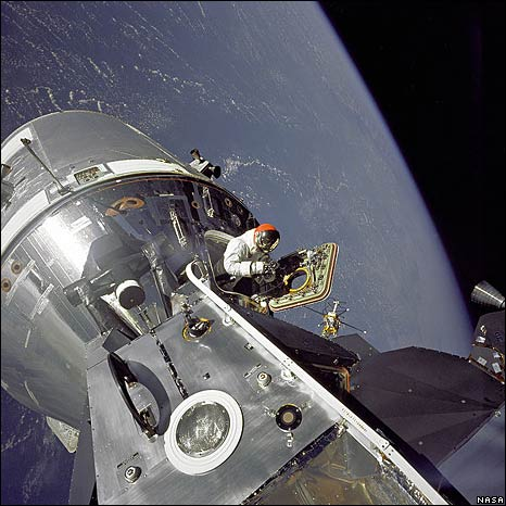 Dave Scott Emerges from the Command Module hatch (Nasa)