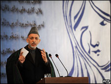 Afghan President Hamid Karzai speaks during International Women's Day